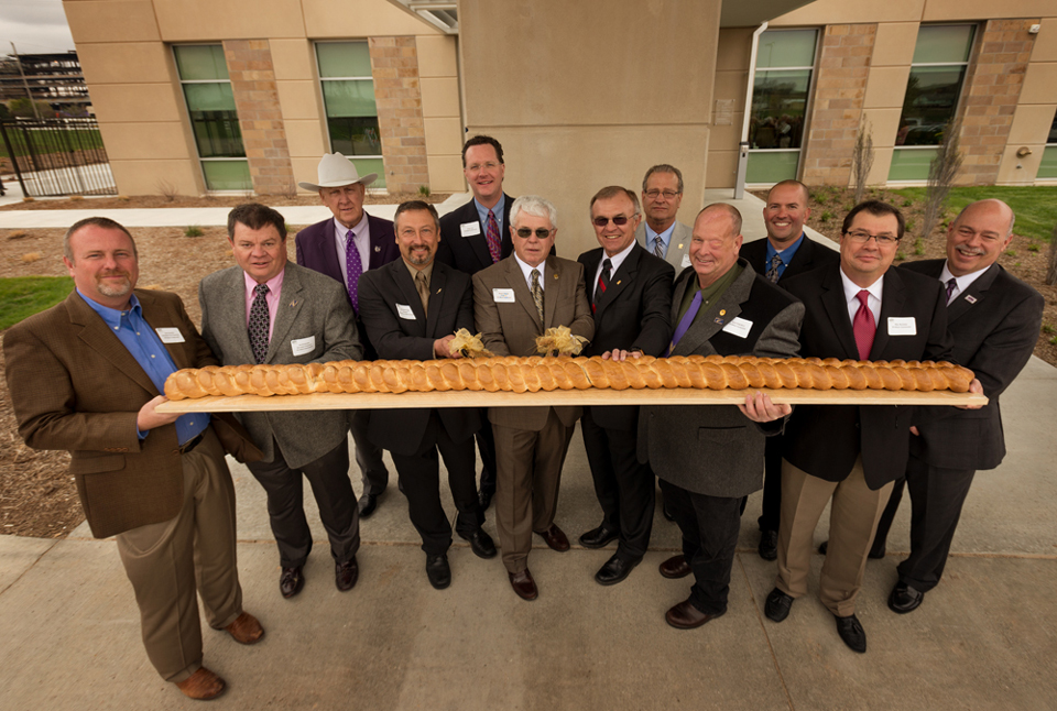 Bread Cutting Ceremony at the Opening of the Kansas Wheat Innovation Center. Photo Courtesy of the Kansas Wheat Commission