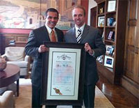 December 9, 2010 - Deputy Assistant Secretary McGowan receives a Certificate of Commendation from Los Angeles Mayor Villaraigosa during his visit to L.A. for the EDA Seattle Regional Conference.