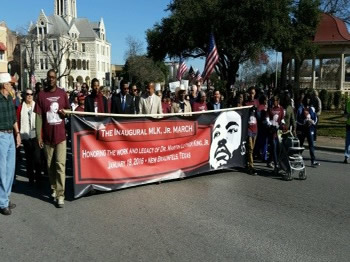 Assistant Secretary Jay Williams participates in the city of New Braunfels, Texas' Inaugural MLK Day march