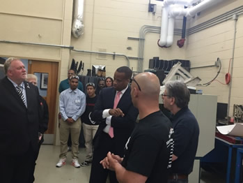 Assistant Secretary Jay Williams touring Asnuntuck Community College's Advanced Manufacturing Center.