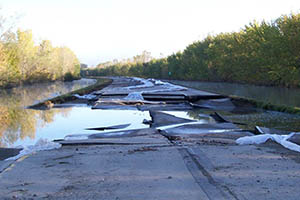 Images of the flooding and damage caused by floods on Highway 169 in Minnesota
