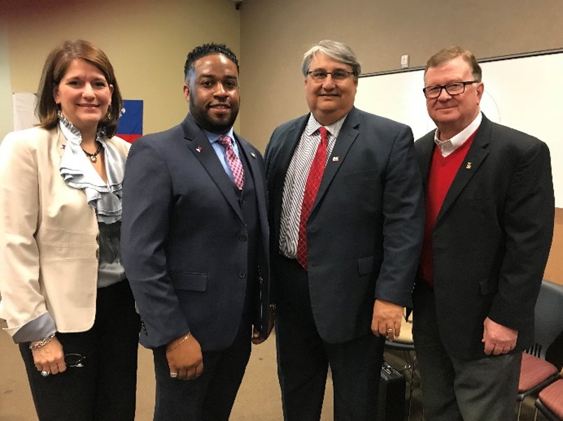 Acadiana Planning Commission CEO, Monique Boulet, EDA AmeriCorps VISTA Keithen Domingue, EDA Austin Regional Director Jorge Ayala and University of Louisiana Lafayette President APC Board Member-Ex-Officio, Dr. Joseph Savoie pose during press conference announcing federal economic development district designation.
