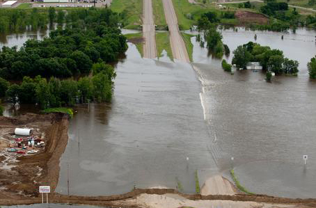 Minot, N.D., June 25, 2011 -- Aerial view of Highway 2, east of Minot closed due to flooding from the Souris River. FEMA Photo by Andrea Booher - Jun 24, 2011 - Location: Minot, ND